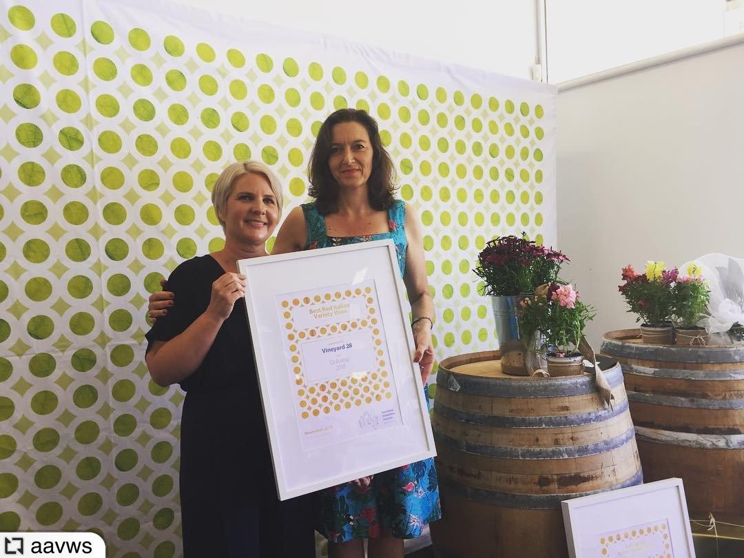 Meg Kopke receiving award on behalf of Vineyard 28
